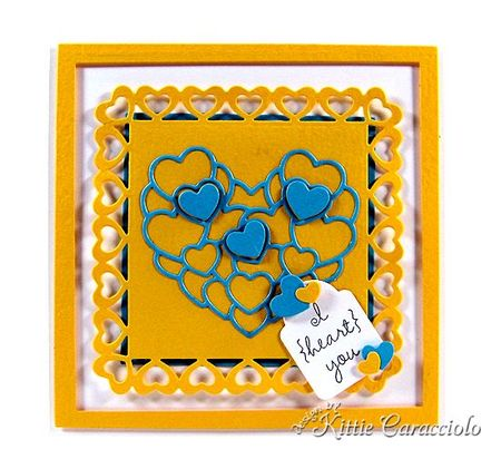 KC Impression Obsession Layered Hearts 1 center