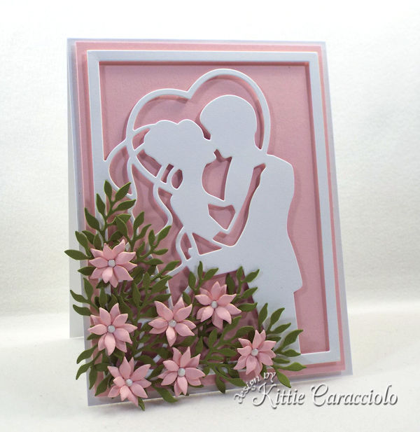 Create an elegant framed wedding card using die cut paper flowers.