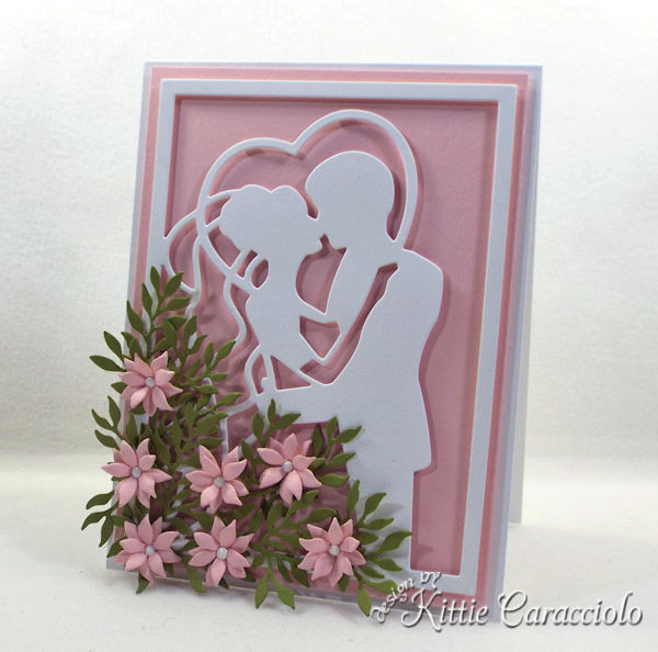 Creating an elegant framed wedding card using die cut paper flowers is easy to do.