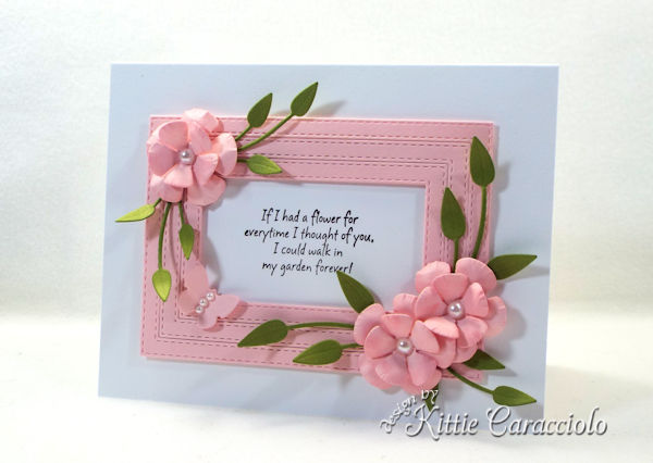 Framed die cut paper flowers make such a lovely elegant card.