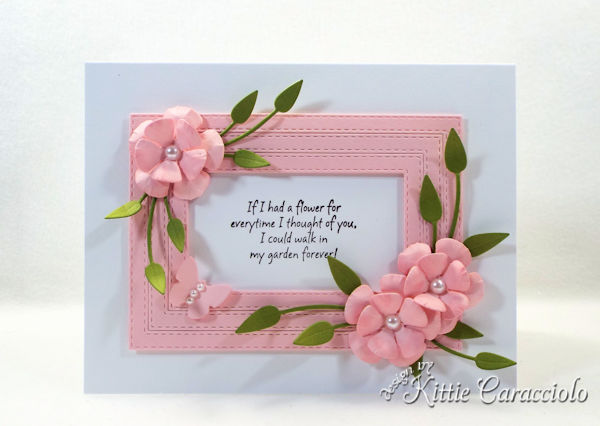 Using framed die cut paper flowers make such a lovely elegant card.