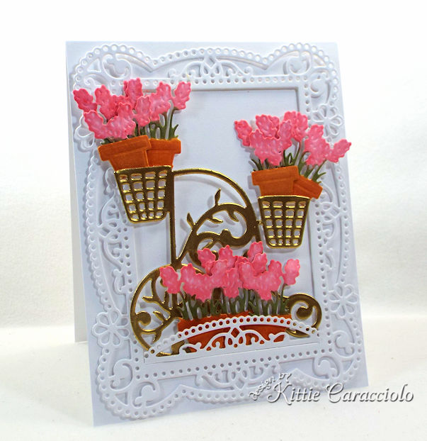 A gold embossed flower cart with a decortive frame makes such a pretty card front and is so much fun.