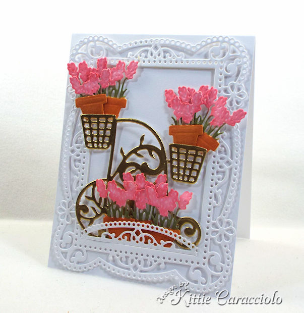 A gold embossed flower cart with a decortive frame makes such a pretty card front.