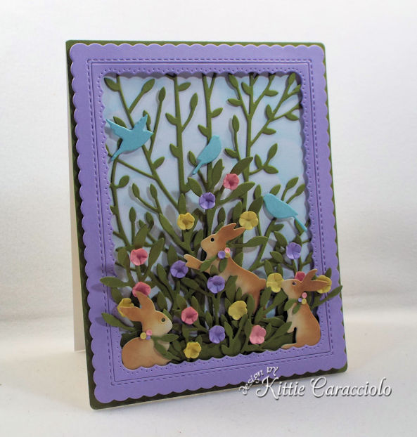 A spring scene with bunny and flower die cuts makes a perfect Easter card.