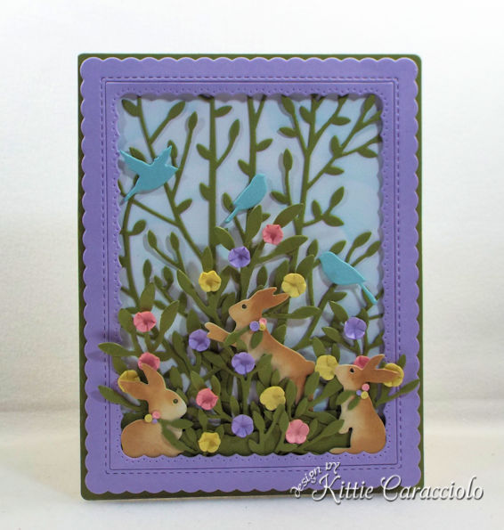 A spring scene with bunny and flower die cuts makes a perfect birthday card for a child.