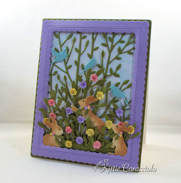 A spring scene with bunny and flower die cuts makes sweet Easter card.