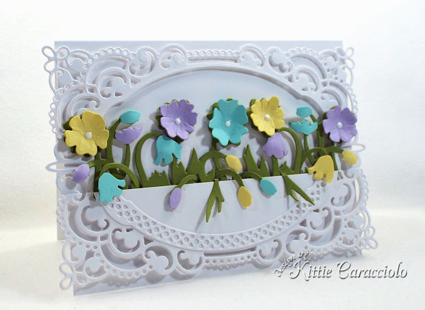 Color layering with die cuts to create dimensional flowers adds so much interest to a project.