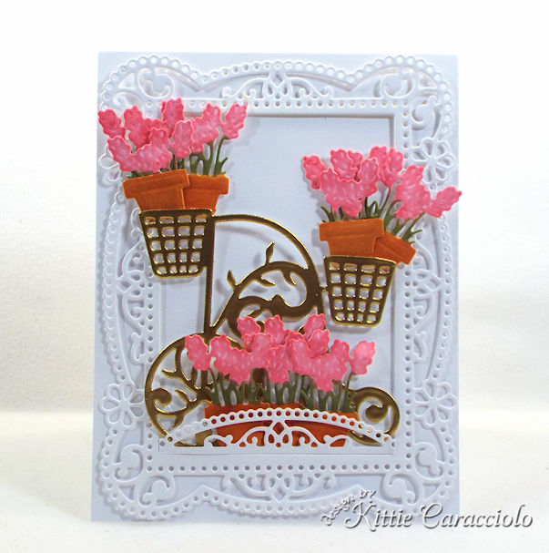 Making a gold embossed flower cart with a decortive frame makes such a pretty card front and is not hard to make.
