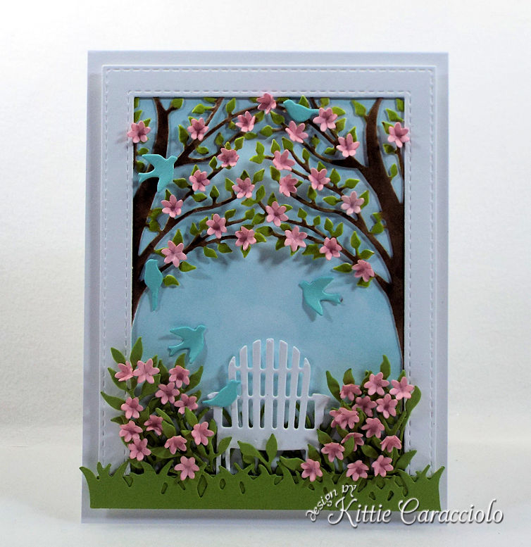 Making a handmade garden scene with die cut birds and flowers is so much fun.