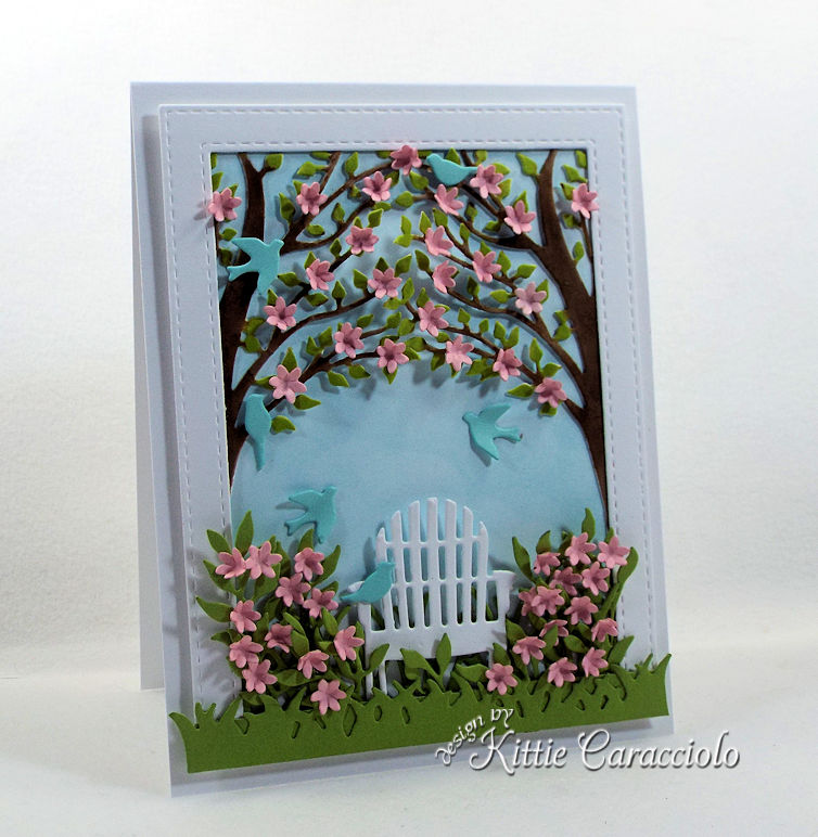 Making a handmade garden scene with die cut birds and flowers on a card front is fun.