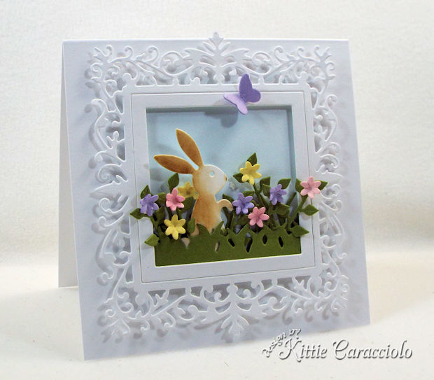 Making an Easter bunny spring scene with flowers is easy and fun.