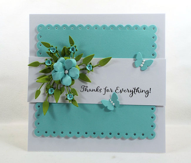 A die cut floral spray is a lovely addition to a card front.