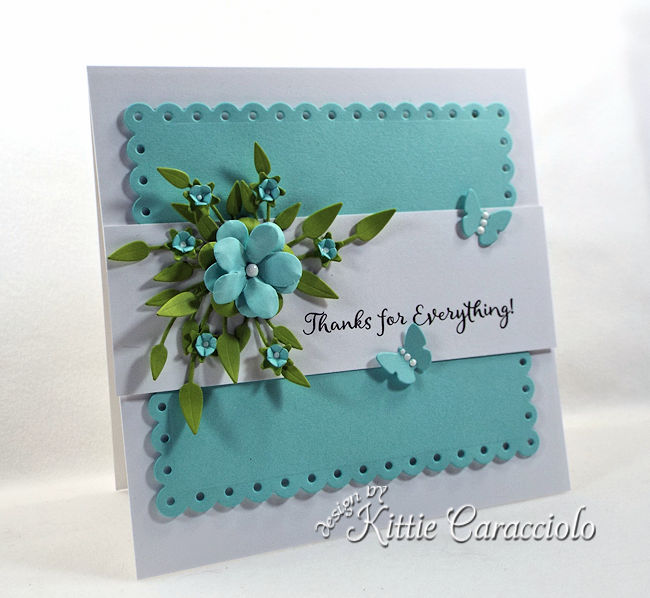 A die cut floral spray is abeautiful addition to a card front.