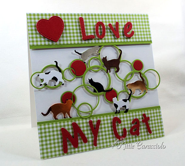A die cut scene with cats makes a great card for children.