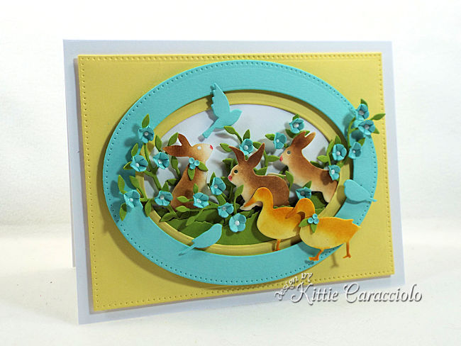 Die cut Easter bunnies, ducks and birds.