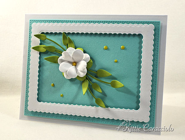 Die cut flowers add dimension and interest to card fronts.