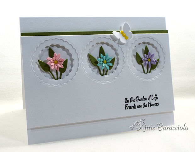 Die cut flowers make such a pretty dimensional card front.