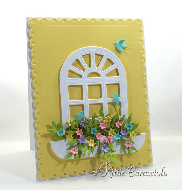 Die cut window scenes with flowers are so cheerful on a card front.