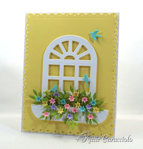 Die cut window scene with flowers.