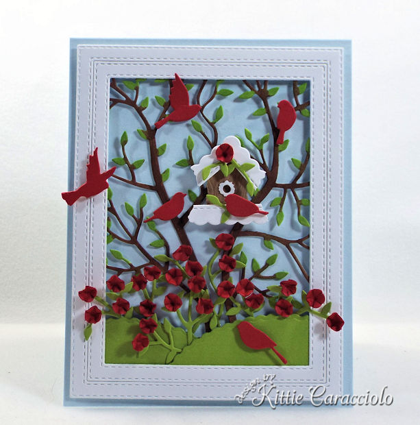 A birdhouse, birds and flowers make such a lovely card front scene.
