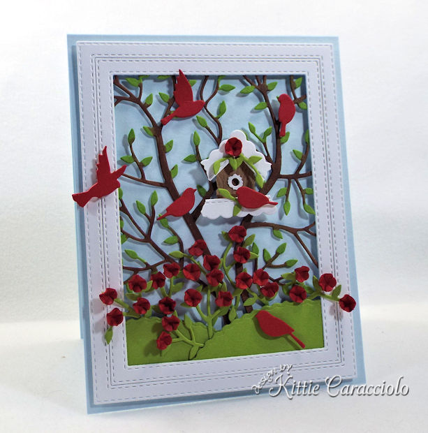 A birdhouse, birds and flowers make such a nature filled card front scene