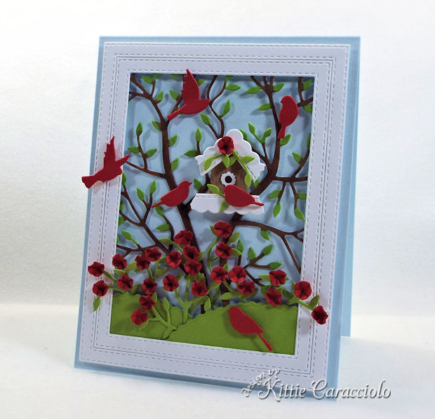 A birdhouse, birds and flowers make such a pretty card front scene.