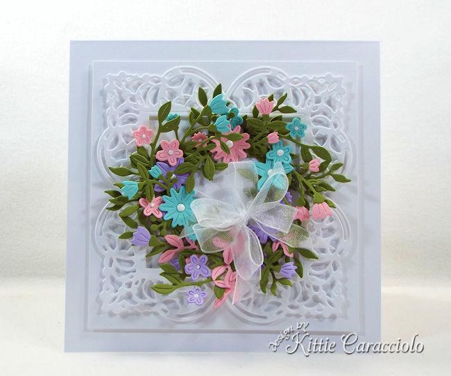 A die cut flower wreath looks so elegant on a card front.