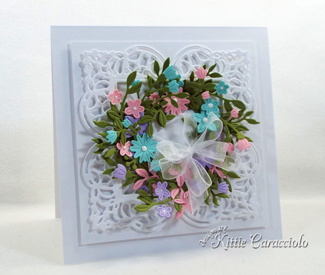 A die cut flower wreath looks so pretty and elegant on a card front.