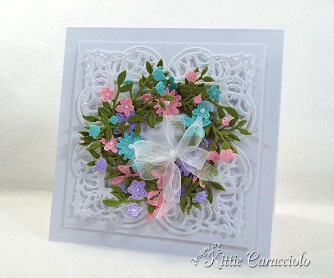 A die cut flower wreath looks so pretty on a card front.