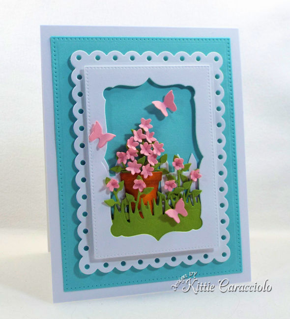 Come check out how I use a die cut flower pot as the main focal point of the framed scene.