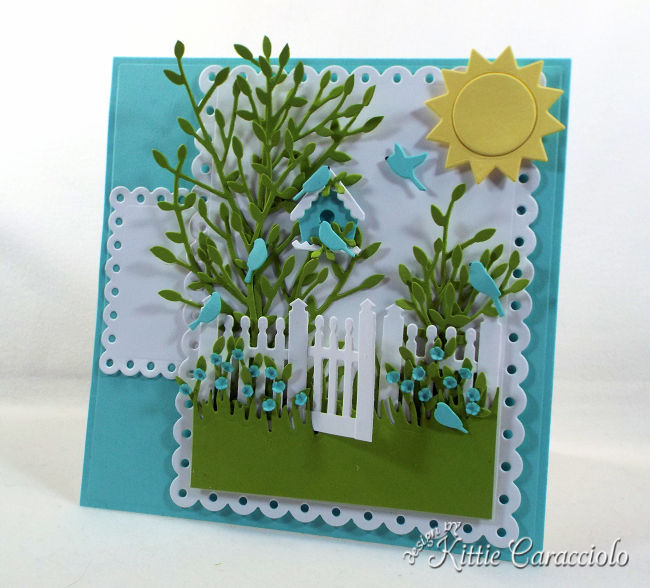 Come see how I created this pretty die cut fence scene for a spring and summer card front
