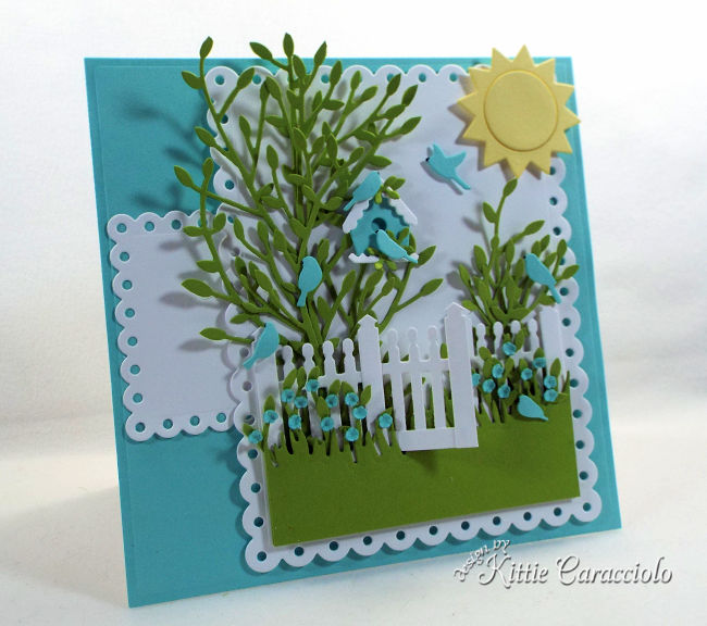 Come see how I created this pretty die cut fence scene for a spring card front.