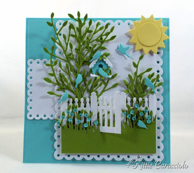 Come see how I created this pretty die cut fence scene for a summer card front