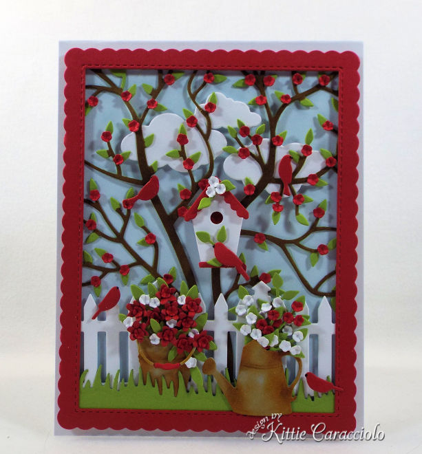 I love creating a die cut bird house scene card with garden and fence images.