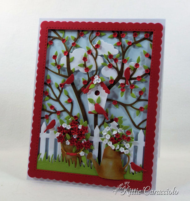 I love creating a die cut bird house scene card with garden images.