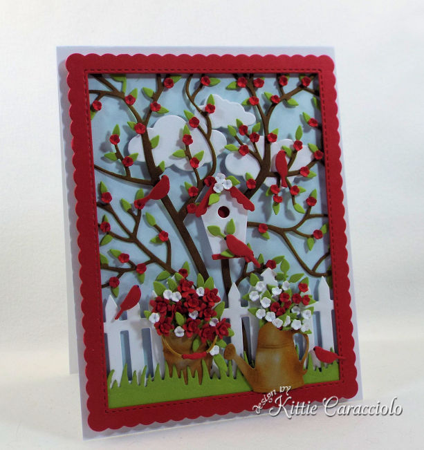 I love creating a die cut bird house scene card with garden images and a tree and cloud background.