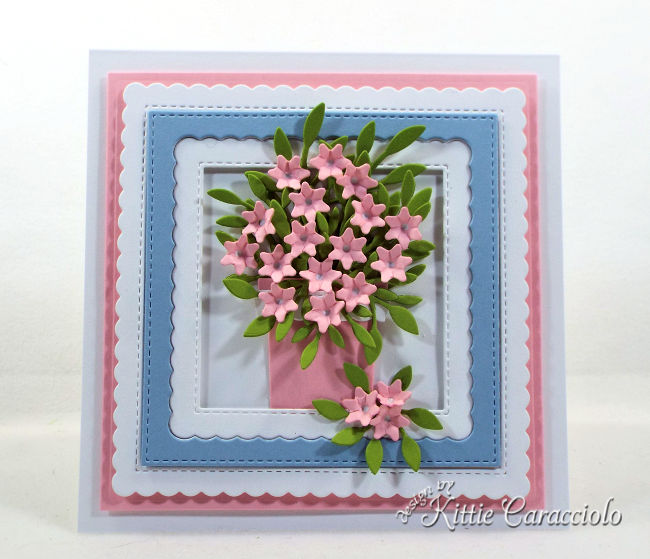 Check out how I made this pretty die cut flower arrangement perfect for a get well or thinking of you card.
