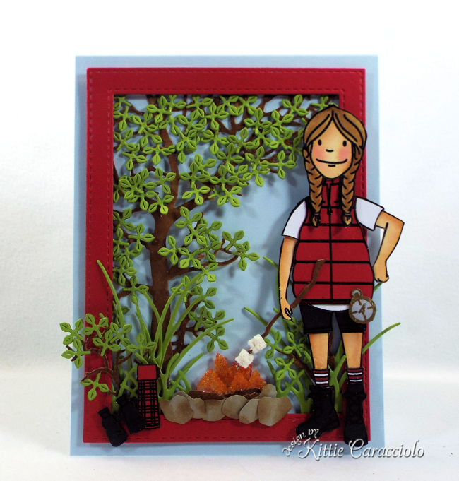 Come check out how I made this die cut camping scene with a foret background, campfire and camper perfect for anyone who loves being outdoors.