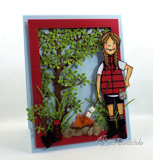 Come check out how I made this die cut camping scene with a foret background, campfire and camper.