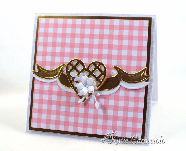 Come check out how I used the Spellbinders June Card Kit of the Month to create a gold heart and floral embellishment.