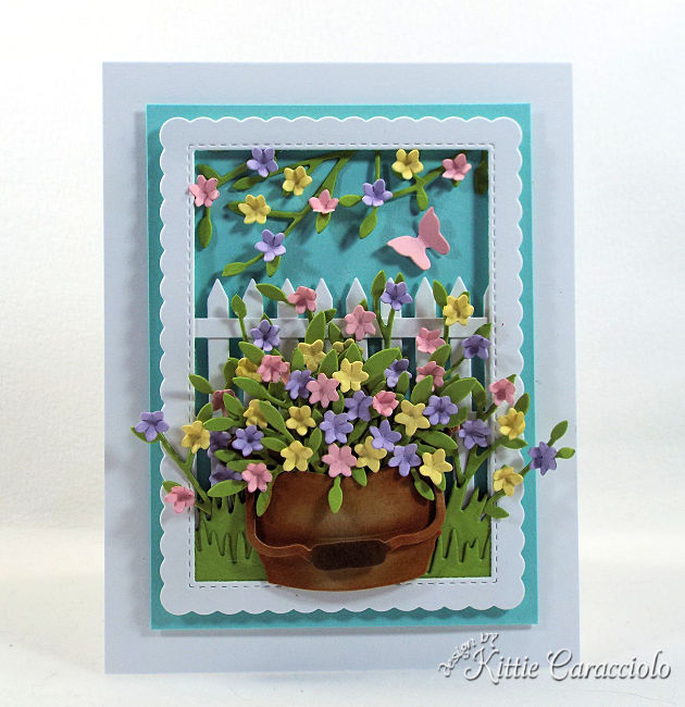 Come see how I made this die cut fence and bucket scene card perfect for anyone who loves gardening.
