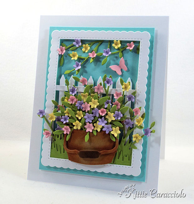 Come see how I made this die cut fence and bucket scene card that would be perfect for a gardener.