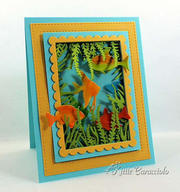 Come see how I made this die cut sea life scene card with brightly colored fish.
