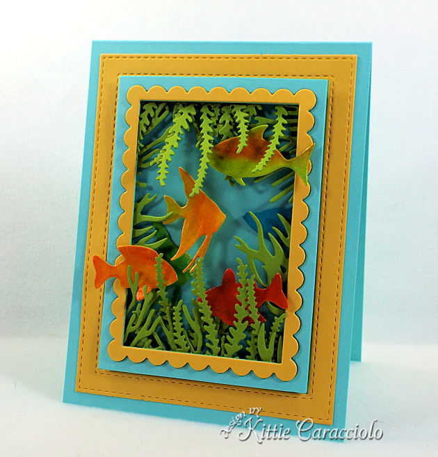 Come see how I made this die cut sea life scene card.