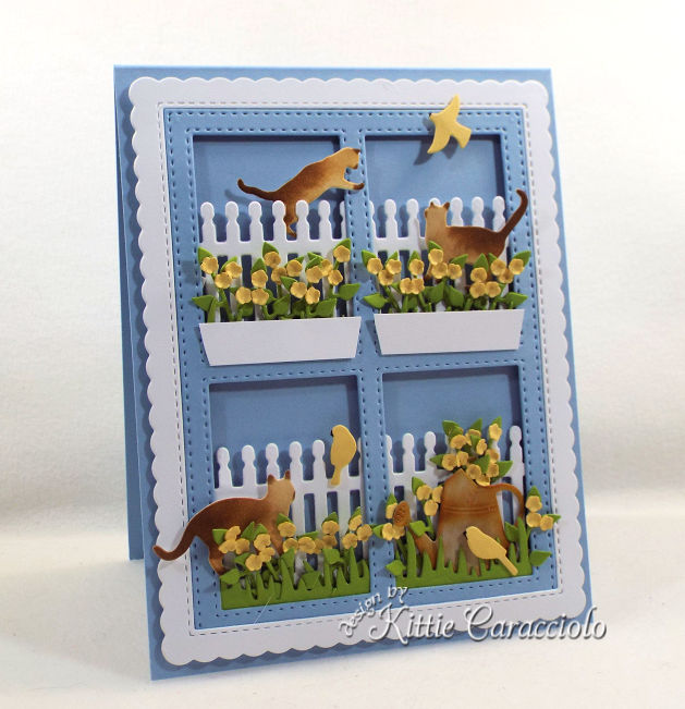 Come see how I made this die cut window scene with cats and birds card perfect for a flower and cagt lover.
