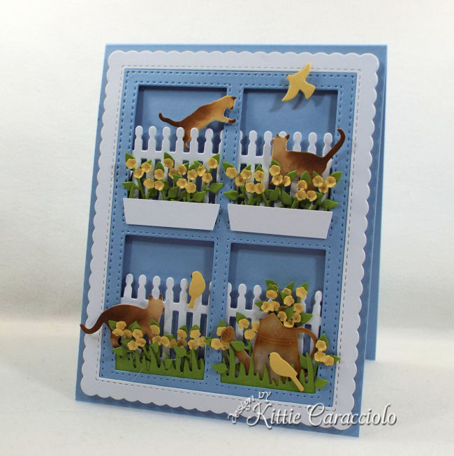 Come see how I made this die cut window scene with cats and birds card perfect for any occasion.