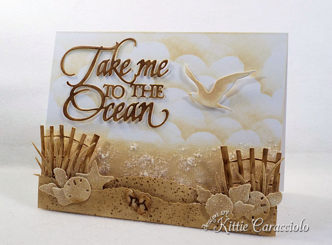 Come see how I made this monochromatic Take Me to the Ocean scene card using Distress Inks and die cuts.