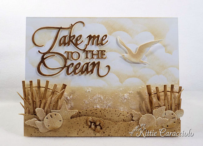 Come see how I made this monochromatic Take Me to the Ocean scene card using Distress Inks.