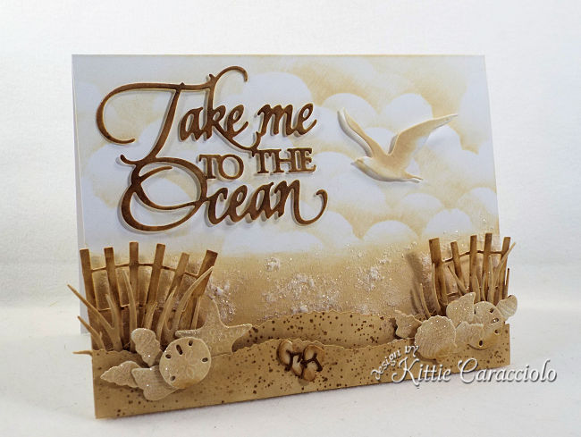 Come see how I made this monochromatic Take Me to the Ocean scene card using die cuts.