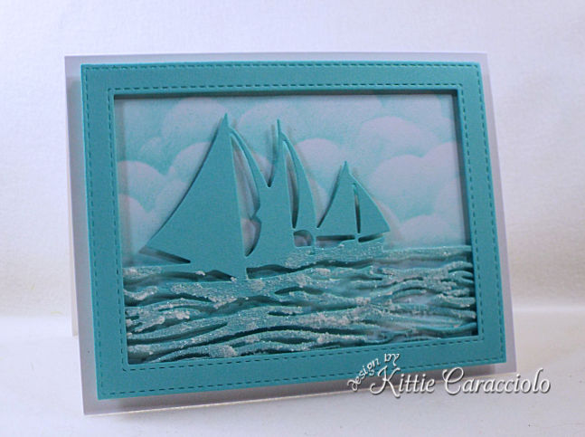 Come see how I made this monochromatic die cut sailboat frame scene perfect for a boat lover.